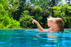 Happy mother with child in swimming pool Stock Photos