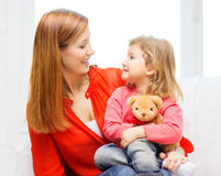 Happy mother and child with teddy bear at home Royalty Free Stock Image