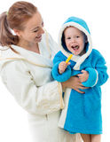 Happy mother and child teeth brushing together stock photography