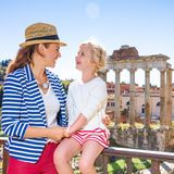 Happy mother and child tourists lin Rome looking at each other Stock Image