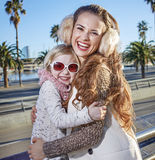 Happy mother and child travellers in Barcelona, Spain embracing Stock Image