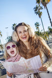 Happy mother and child travellers in Barcelona, Spain with map Royalty Free Stock Photos
