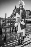 Happy mother and child travellers holding Venetian mask, Venice Royalty Free Stock Image