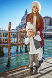 Happy mother and child travellers holding Venetian mask, Venice Stock Images