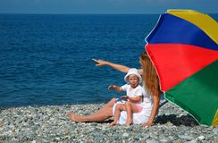 Happy mother with child under umbrella Royalty Free Stock Images