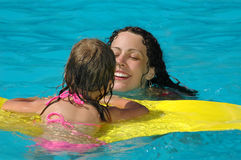 Happy mother and child in water pool. Happy mother and child have fun in pool Royalty Free Stock Image
