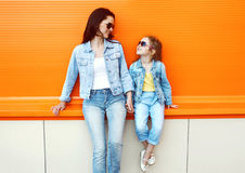 Happy mother and child wearing a jeans clothes Stock Photo