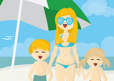Happy mother with children on a beach Stock Image