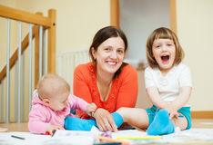 Happy mother with children an home royalty free stock image