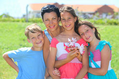 Happy mother with children. Portrait of a happy mother with children outdoors stock images