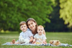 Happy mother with children in summer park. royalty free stock photos