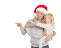 Happy mother in Christmas hat holding baby girl Stock Photos