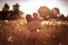 Happy mother communication with daughter in a wheat field Royalty Free Stock Images