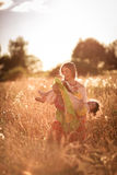 Happy mother communication with daughter in a wheat field Stock Photography
