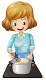 A happy mother cooking Royalty Free Stock Photography