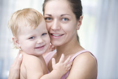 Happy Mother Cuddling Baby Girl Royalty Free Stock Photo