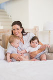 Happy mother with cute babies boy and girl Royalty Free Stock Photos