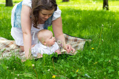 Happy mother and cute baby girl playing outdoor Stock Photography