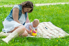 Happy mother and cute baby girl playing outdoor Royalty Free Stock Images