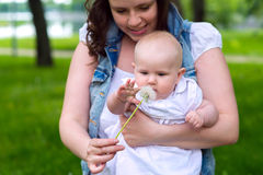 Happy mother and cute baby girl playing outdoor Stock Photos