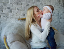 Happy mother with cute baby. Photo of happy mother with cute baby Royalty Free Stock Image