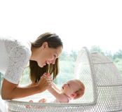 Happy mother and cute baby playing Royalty Free Stock Photos