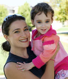 Happy mother and daughter. An outdoor portrait of happy mother and daughter Stock Images