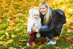 Happy mother with daughter in autumn park Stock Images