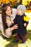Happy mother with daughter in autumn park Stock Image