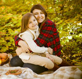 Happy mother with daughter on autumn picnic Royalty Free Stock Photography