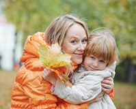 Happy mother and daughter in autumn Royalty Free Stock Photo