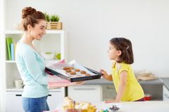 Happy mother and daughter baking cookies at home Stock Photography