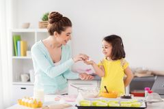Happy mother and daughter baking at home Stock Image
