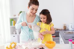 Happy mother and daughter baking at home Royalty Free Stock Photos