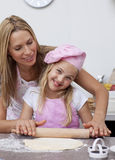 Happy mother and daughter baking in the kitchen Royalty Free Stock Photos