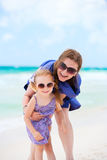 Happy mother and daughter at beach Royalty Free Stock Photography