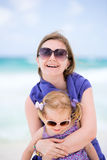 Happy mother and daughter at beach Stock Photo