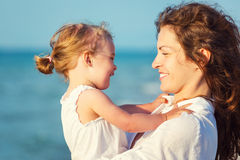 Happy mother and daughter on the beach Royalty Free Stock Photo