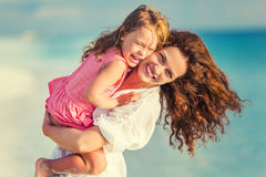 Happy mother and daughter on the beach Stock Photos