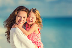Happy mother and daughter on the beach Royalty Free Stock Image