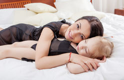 Happy Mother and daughter in bed Royalty Free Stock Images