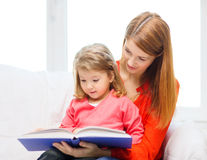 Happy mother and daughter with book Royalty Free Stock Photo
