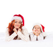A happy mother and a daughter in Christmas hats Stock Photo