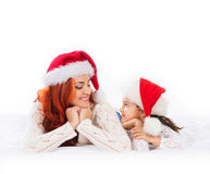 A happy mother and a daughter in Christmas hats Stock Images
