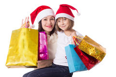 Happy mother and daughter on Christmas shopping royalty free stock images