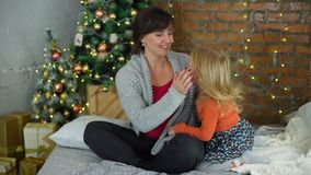 Happy Mother and Daughter on Christmas in Slow Mothion. Mother and Daughter Having Fun near the Christmas Tree in Slow Motion stock video