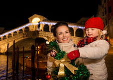 Happy mother and daughter with Christmas tree in Venice, Italy. Stock Image