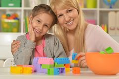 Mother and daughter collecting blocks Stock Image