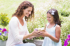 Happy mother and daughter collecting easter eggs Stock Photo