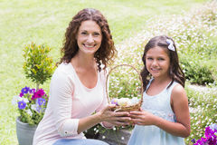 Happy mother and daughter collecting easter eggs Royalty Free Stock Image